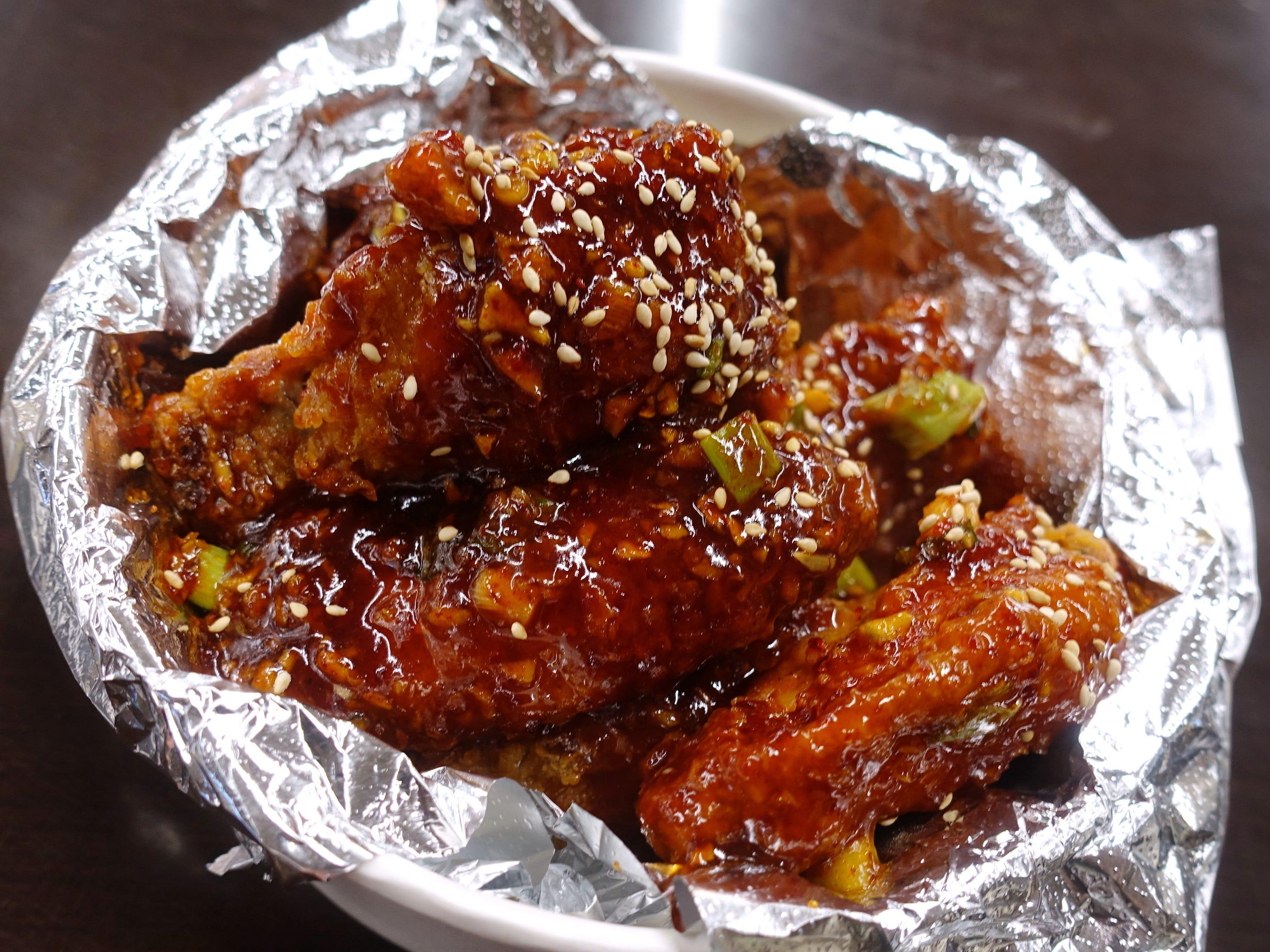 Spicy gochujang chicken wings at Katsu at Asiana Market in Mesa.
