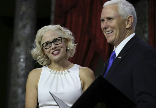 Kyrsten Sinema is sworn in by Vice President Mike Pence during the swearing-in re-enactments for recently elected senators in the Old Senate Chamber on Capitol Hill on Jan. 3, 2019.