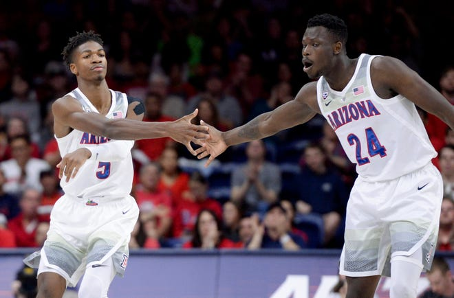 Dec 22, 2018: Arizona Wildcats guard Brandon Randolph (5) and guard Emmanuel Akot (24) celebrate after scoring against the UC Davis Aggies during the second half at McKale Center.