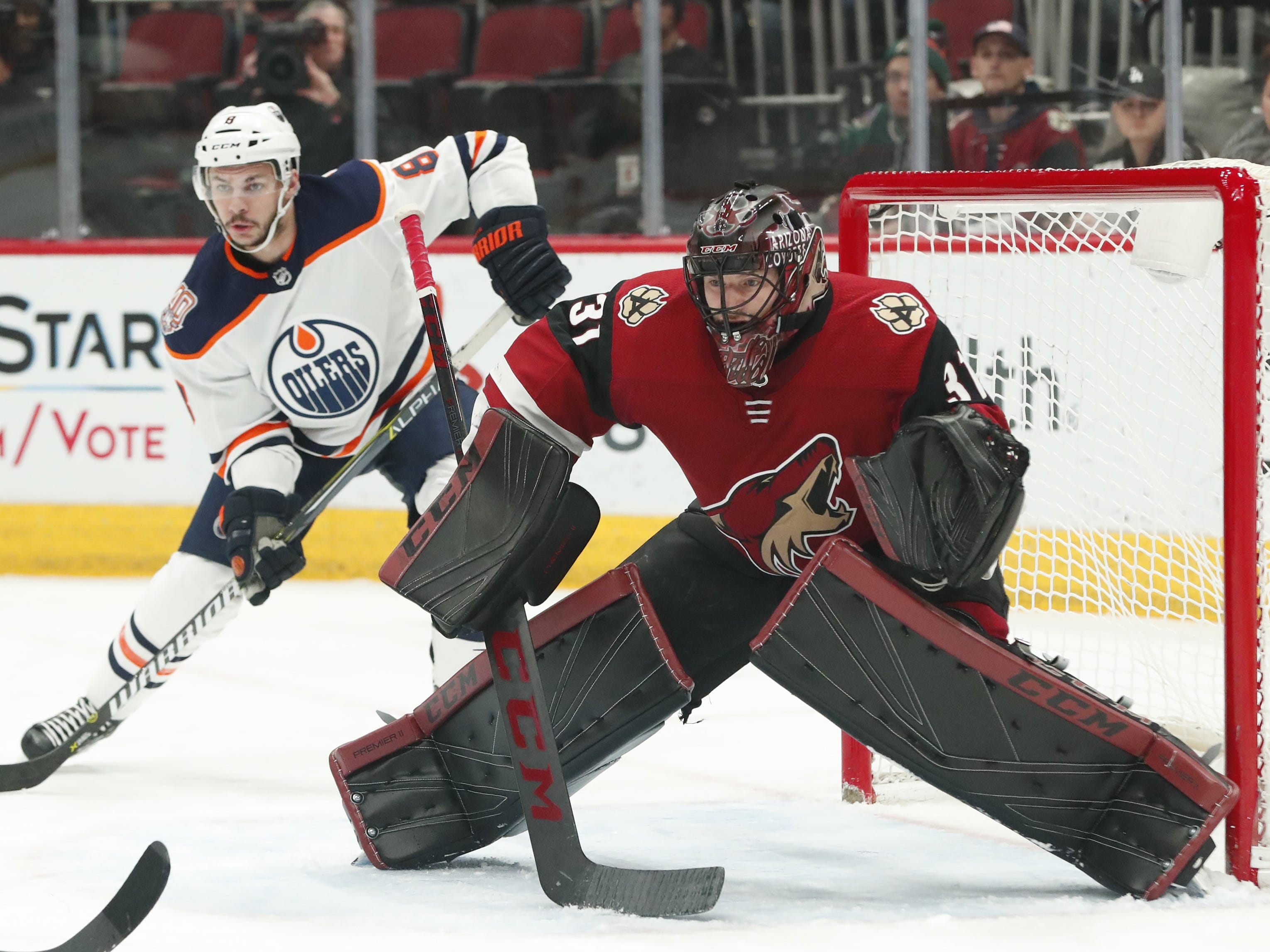 Arizona Coyotes goaltender Adin Hill (31) defends the net against Edmonton Oilers right wing Ty Rattie (8) during the first period in Glendale January 2, 2019.
