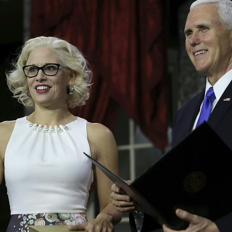 Kyrsten Sinema's dress is back — in the New York Times