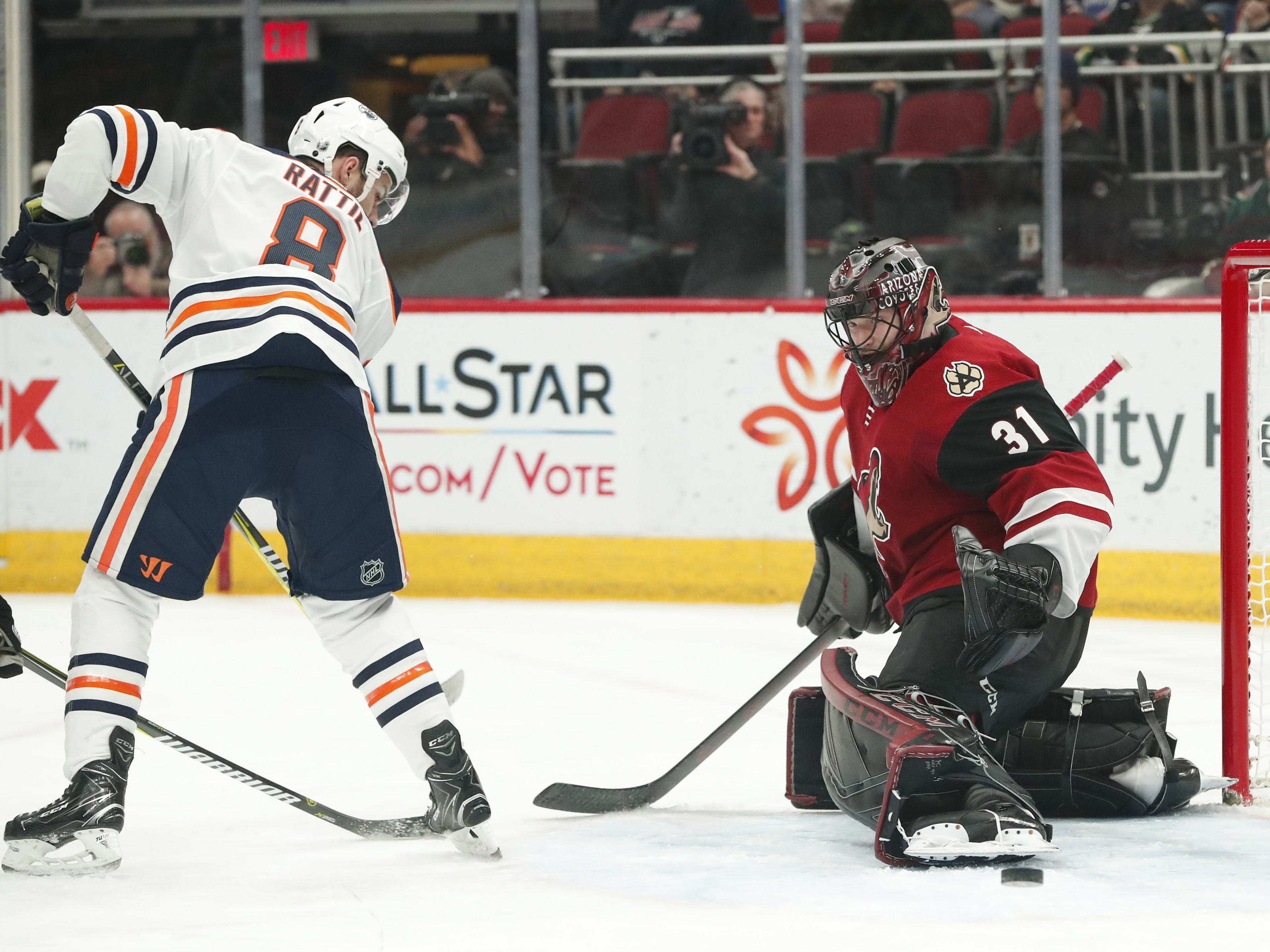 Arizona Coyotes goaltender Adin Hill (31) makes a save off a deflection by Edmonton Oilers right wing Ty Rattie (8) during the first period in Glendale January 2, 2019.