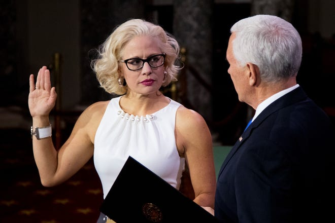 Vice President Mike Pence administers a ceremonial Senate oath during a mock swearing-in ceremony to Sen. Kyrsten Sinema on Thursday, Jan. 3, 2019, in the Old Senate Chamber on Capitol Hill in Washington.
