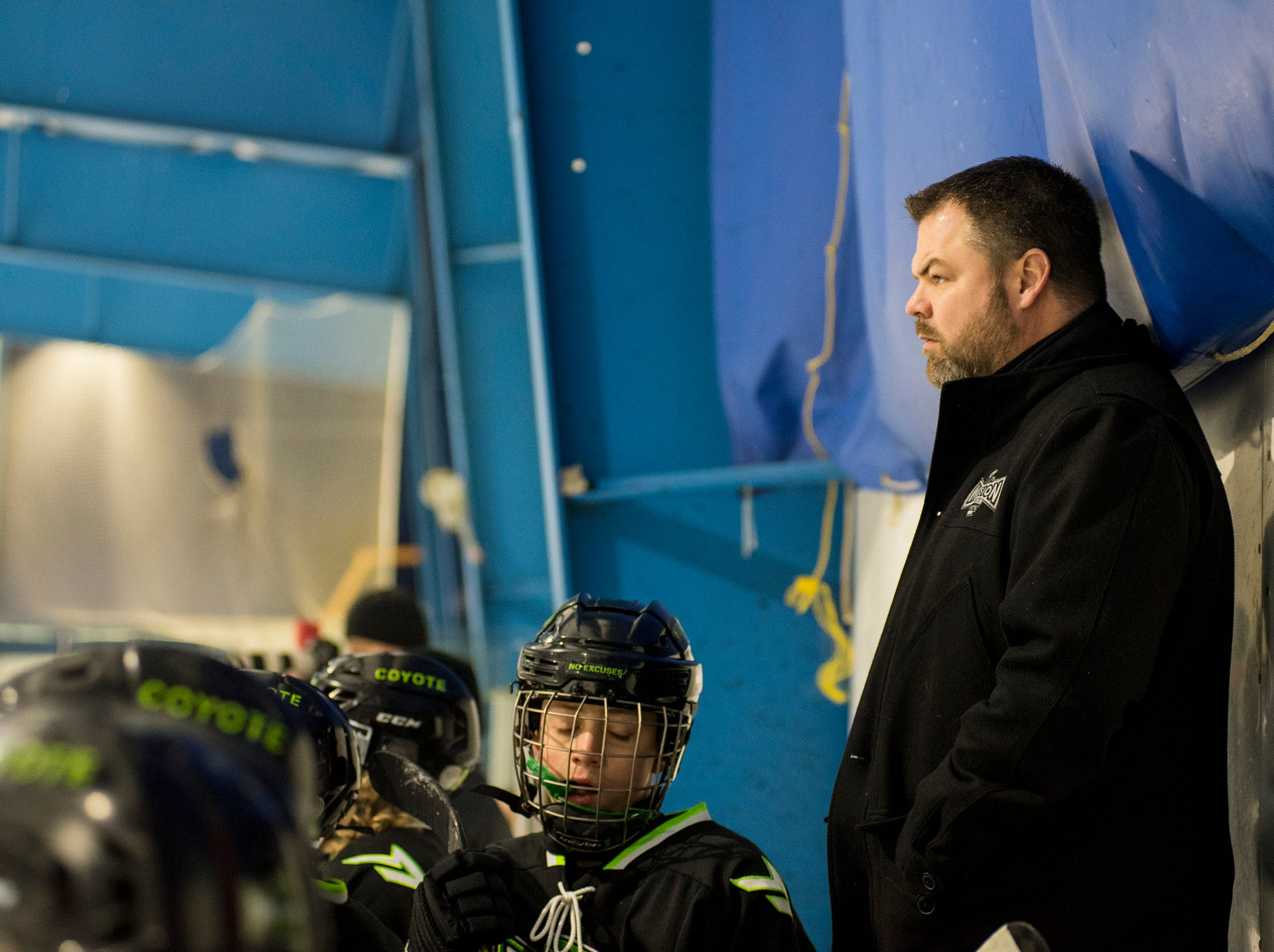 Chicago Mission head coach Chris Kaspar watches  their Silver Stick Finals PAAA-B match against Huron Perth Lakers Thursday, Jan. 3, 2019 at Glacier Pointe Ice Complex.