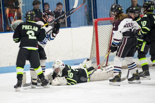 Chicago Mission goalie Teddy Huddlestun (50) drops to the ice to stop the puck during their Silver Stick Finals PAAA-B match against Huron Perth Lakers Thursday, Jan. 3, 2019 at Glacier Pointe Ice Complex.