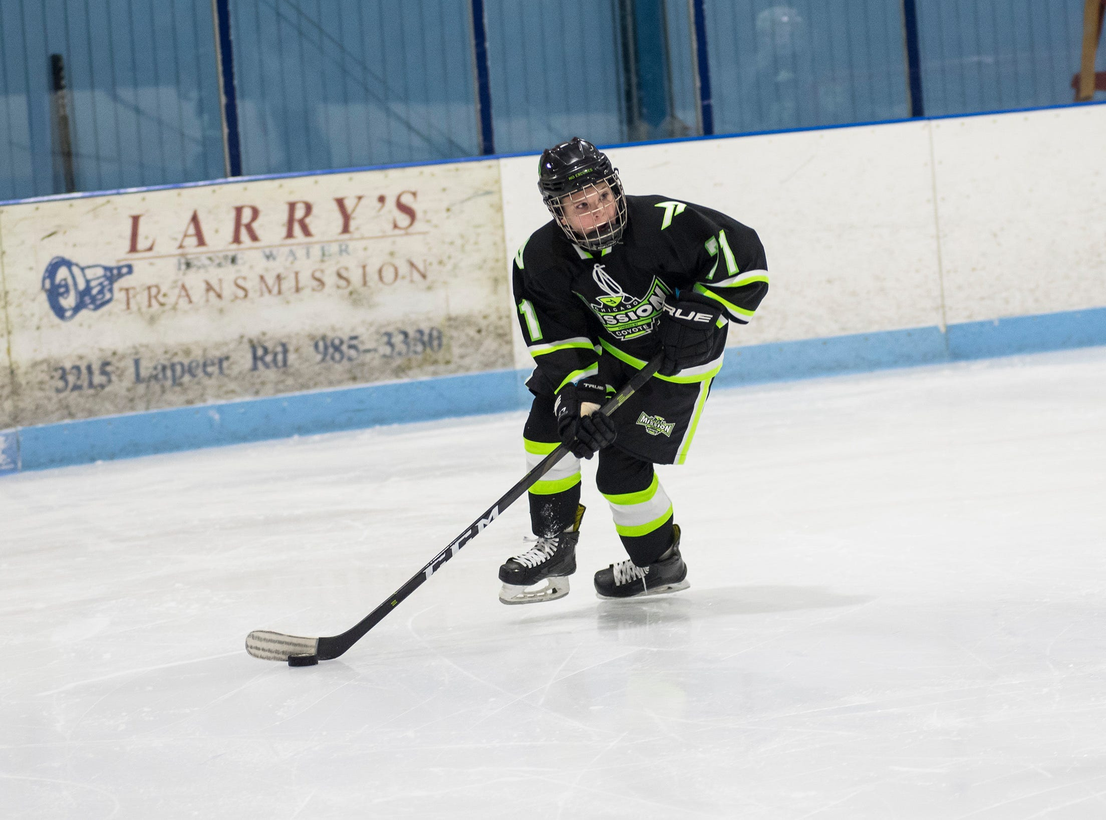 Chicago Mission forward David O'Neill skates with the puck during their Silver Stick Finals PAAA-B match against Huron Perth Lakers Thursday, Jan. 3, 2019 at Glacier Pointe Ice Complex.