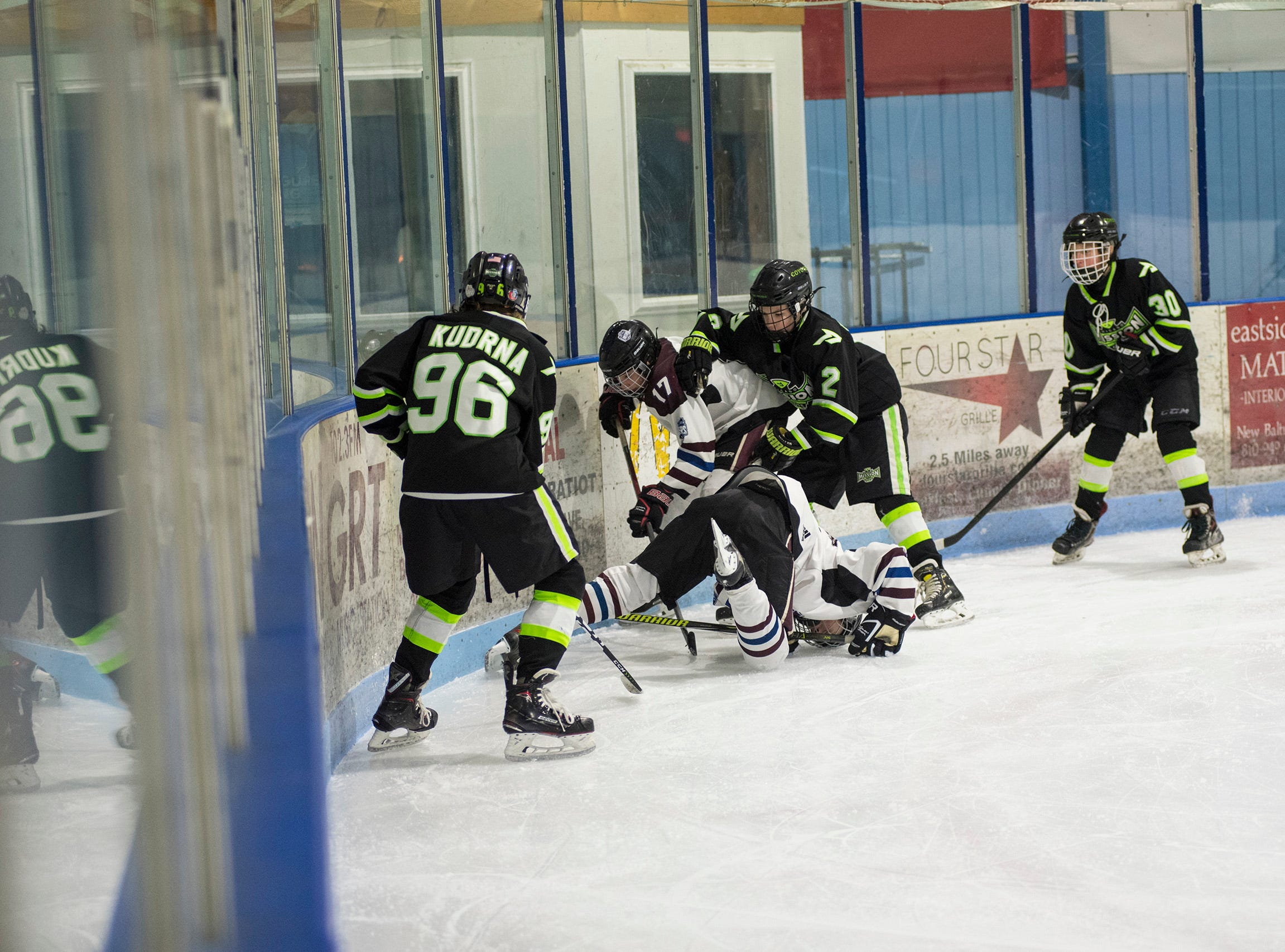 Players from Chicago Mission and Huron Perth Lakers fight for the puck during their Silver Stick Finals PAAA-B match Thursday, Jan. 3, 2019 at Glacier Pointe Ice Complex.