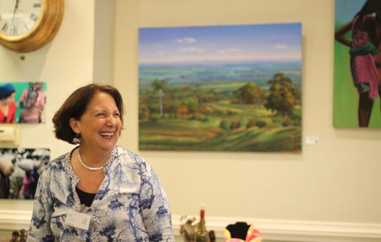 Vassar Haiti Project co-founder Lila Meade is surrounded by artwork purchased from Haiti for the purpose of her charity.