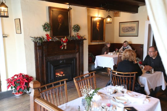Guests dine by a fireplace in the Tavern at Beekman Arms in Rhinebeck on December 27, 2018.