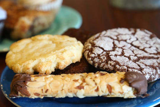 Vegan treats, the almond stick, lemon cookie, chocolate brownie and chocolate crinkle cookie at Sweet Obsessions Cafe in the Town of Poughkeepsie on January 3, 2019.