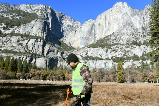 Anthony Martinez, 42, picks up trash along the main road into Yosemite Valley on Jan. 2, 2019. Martinez spent his day off from work at nearby Tenaya Lodge to pick up trash inside Yosemite durirng the 2018/19 government shutdown.