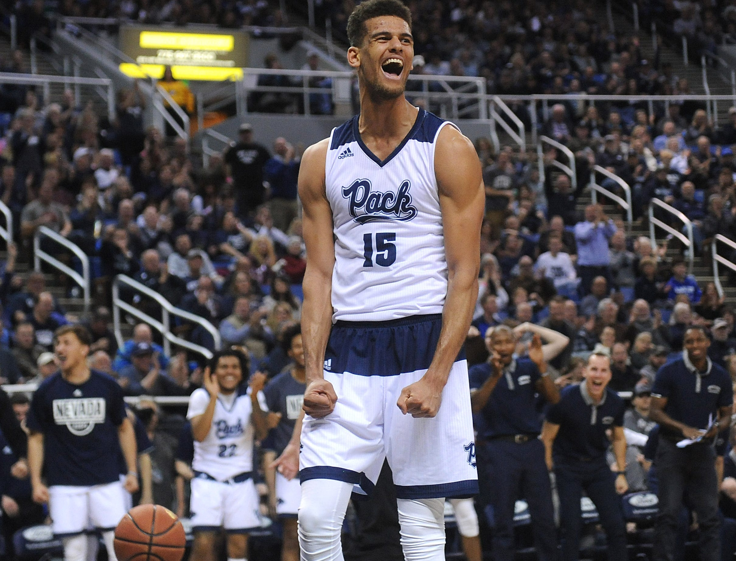Nevada's Trey Porter celebrates after scoring against Utah St. during their basketball game at Lawlor Events Center in Reno on Jan. 2, 2019.