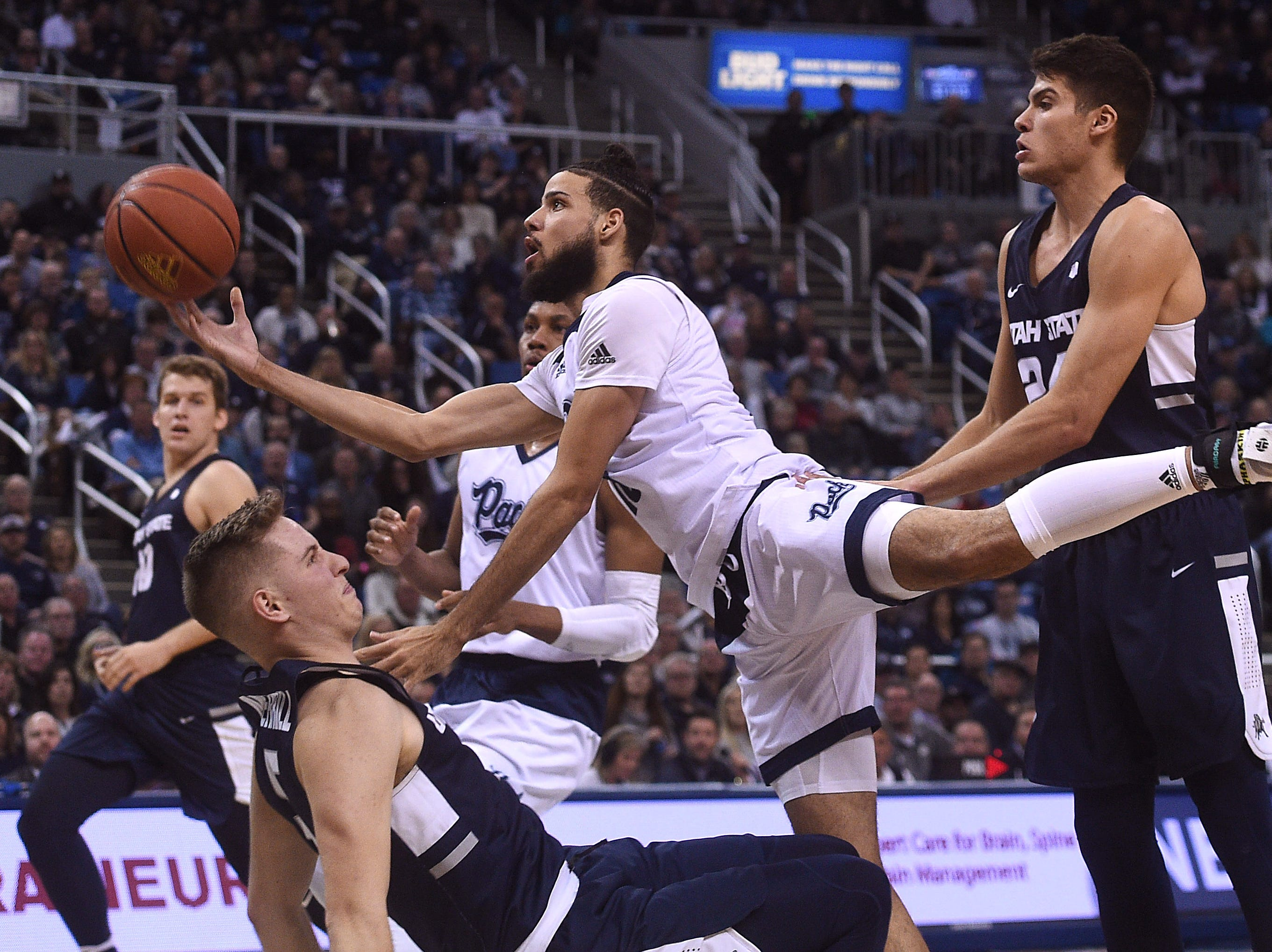 Nevada's Caleb Martin drives against Utah St. during their basketball game at Lawlor Events Center in Reno on Jan. 2, 2019.