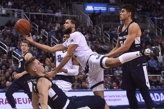 The Wolf Pack's Caleb Martin drives against Utah State earlier this month. On Wednesday, he scored 21 second-half points against San Jose State.