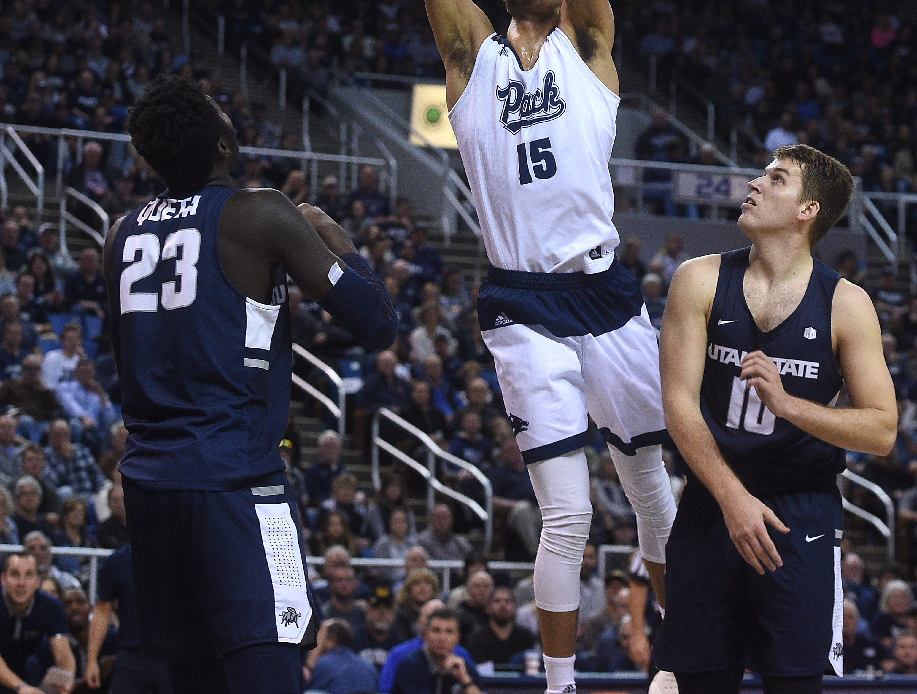 Nevada's Trey Porter shoots while taking on Utah St. during their basketball game at Lawlor Events Center in Reno on Jan. 2, 2019.