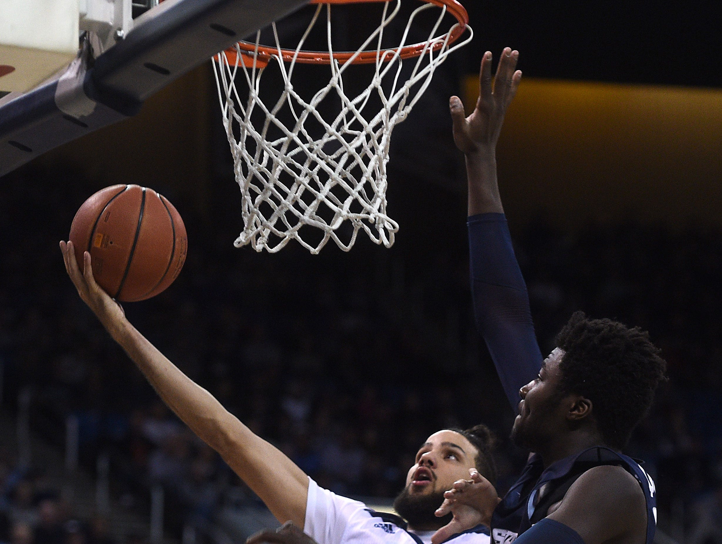 Nevada's Caleb Martin drives to the basket against Utah St. during their basketball game at Lawlor Events Center in Reno on Jan. 2, 2019.