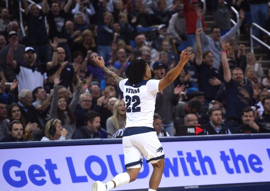 Nevada's Jazz Johnson celebrates after scoring against Utah State during the teams' Mountain West opener in  Reno.