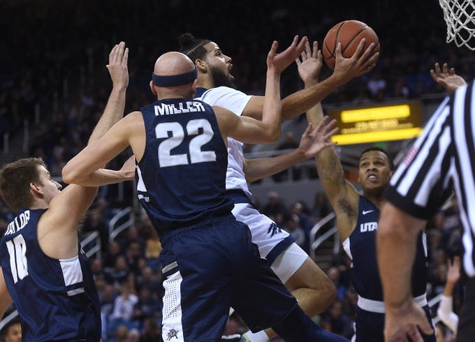 Nevada's Caleb Martin (10) drives to the basket while taking on Utah St. during their basketball game at Lawlor Events Center in Reno on Jan. 2, 2019.