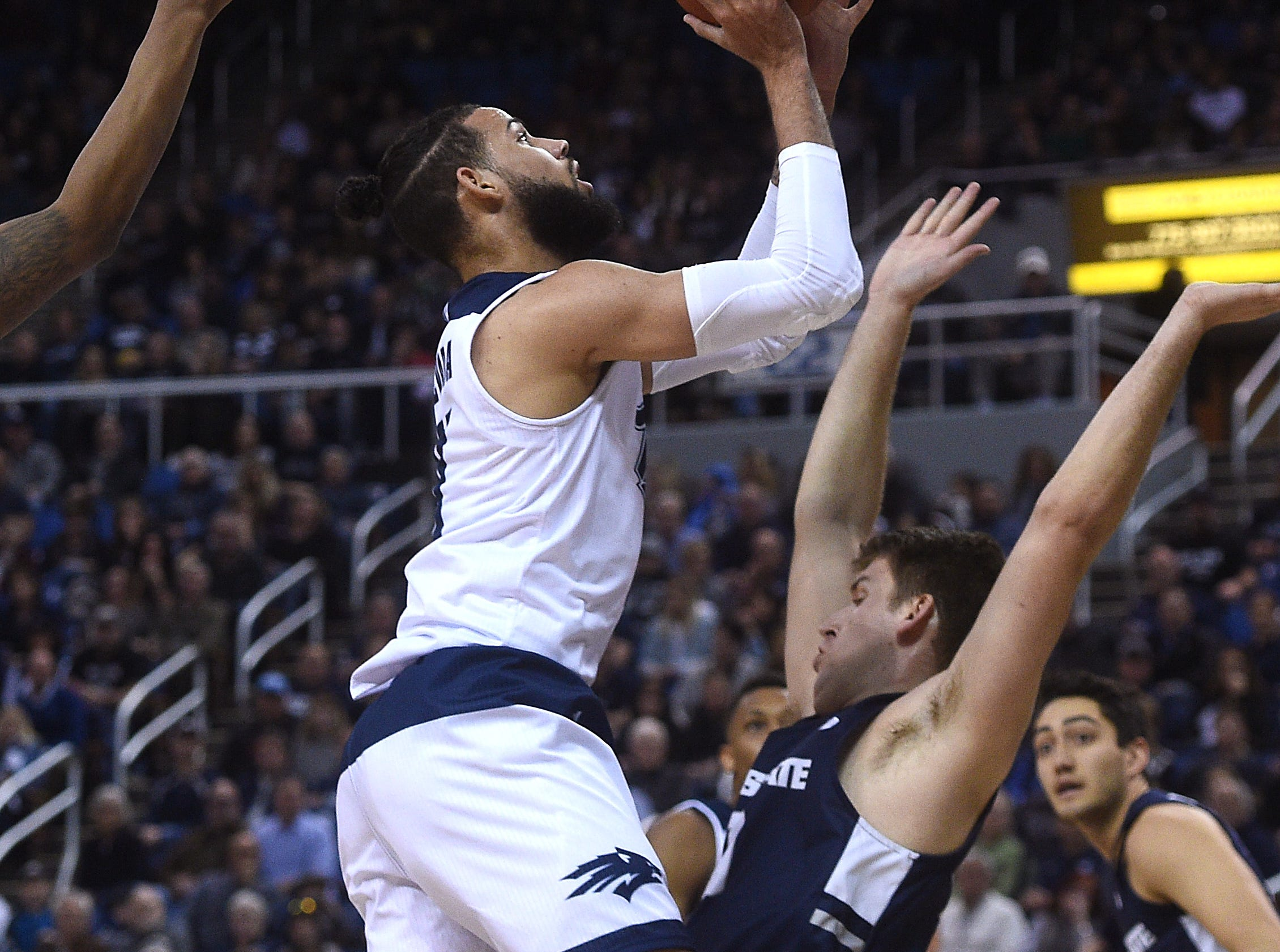 Nevada's Cody Martin (11) shoots while taking on Utah St. during their basketball game at Lawlor Events Center in Reno on Jan. 2, 2019.