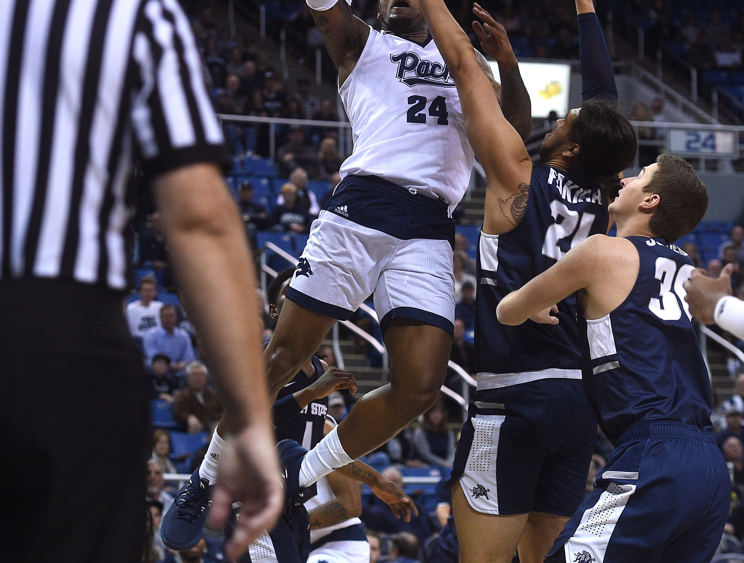 Nevada's Jordan Caroline drives to the basket while taking on Utah St. during their basketball game at Lawlor Events Center in Reno on Jan. 2, 2019.