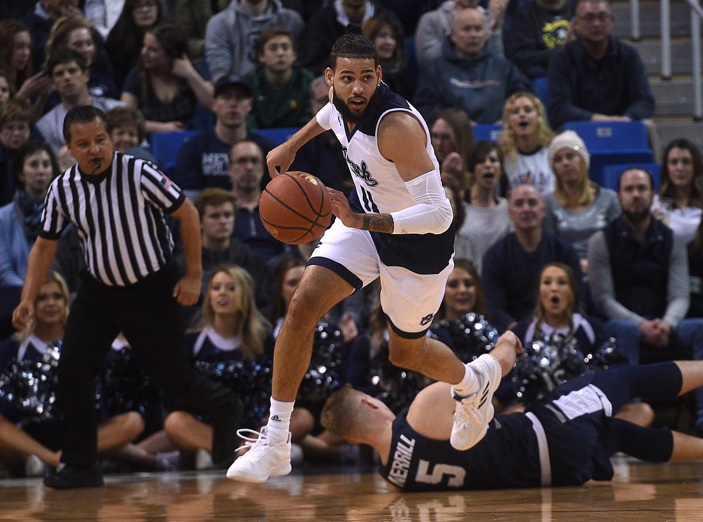 Nevada's Cody Martin (11) heads up court while taking on Utah St. during their basketball game at Lawlor Events Center in Reno on Jan. 2, 2019.