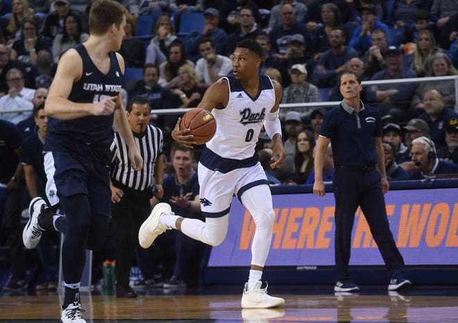 Nevada's Tre'Shawn Thurman brings the ball up against Utah State last week at Lawlor Events Center.
