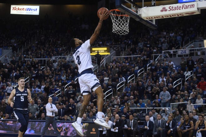 Nevada's Corey Henson scores after a steal late in the first half of the Pack's win over Utah State on Wednesday.