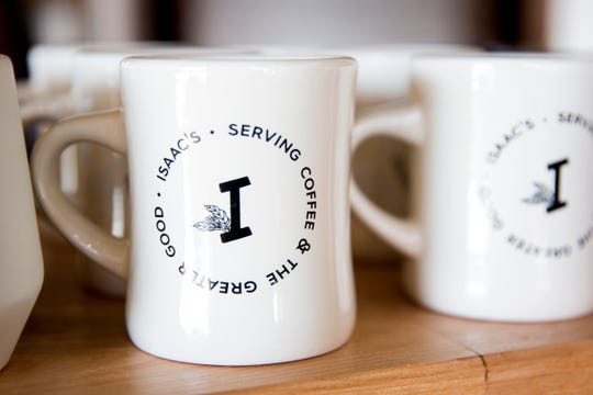 Coffee mugs at Isaac's Downtown, a new café in downtown Salem on Wednesday, Jan. 2, 2019. The coffee shop is from the owners of IKE Box and Isaac's Room.