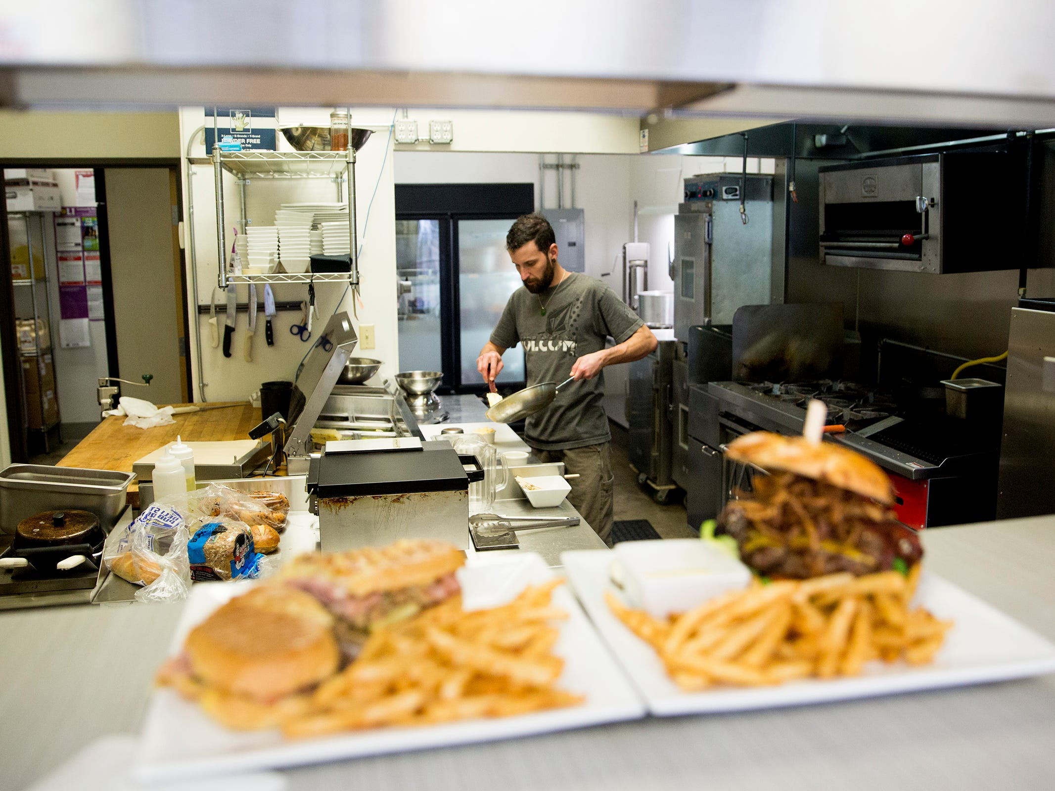 Line cook Josh Thomassen in the kitchen at Santiam Brewing in Salem on Wednesday, Jan. 2, 2019.