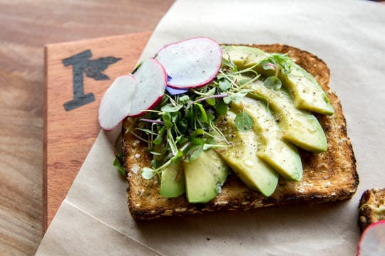 Toast with avocado, micro greens, radishes, cracked black pepper and flaked sea salt at Isaac's Downtown in Salem on Thursday, Jan. 3, 2019. The menu item is called Petaluma.