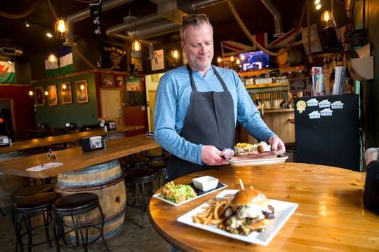 Pitmaster Chad Lewis serves barbecue at Santiam Brewing in Salem on Wednesday, Jan. 2, 2019.