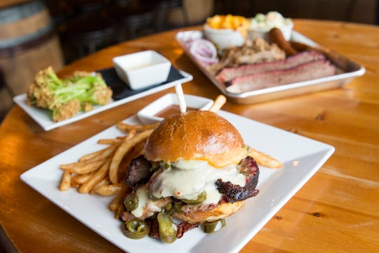 The El Brisket Inferno with sliced smoked brisket, jalapeños, pepper jack cheese and chipotle aioli on a pretzel bun at Santiam Brewing in Salem on Wednesday, Jan. 2, 2019.