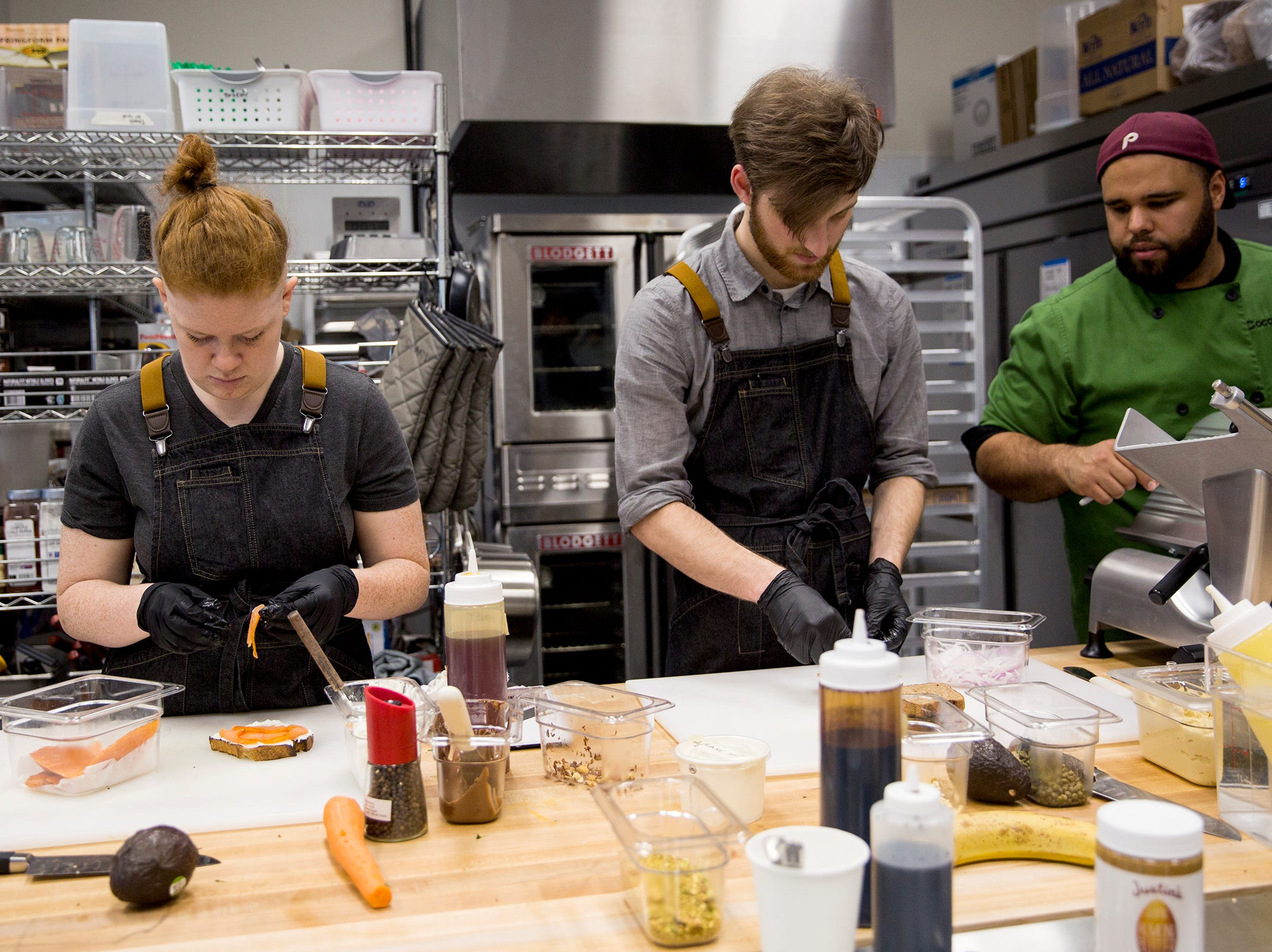 Employees train to make specialty toast at Isaac's Downtown in Salem on Thursday, Jan. 3, 2019.