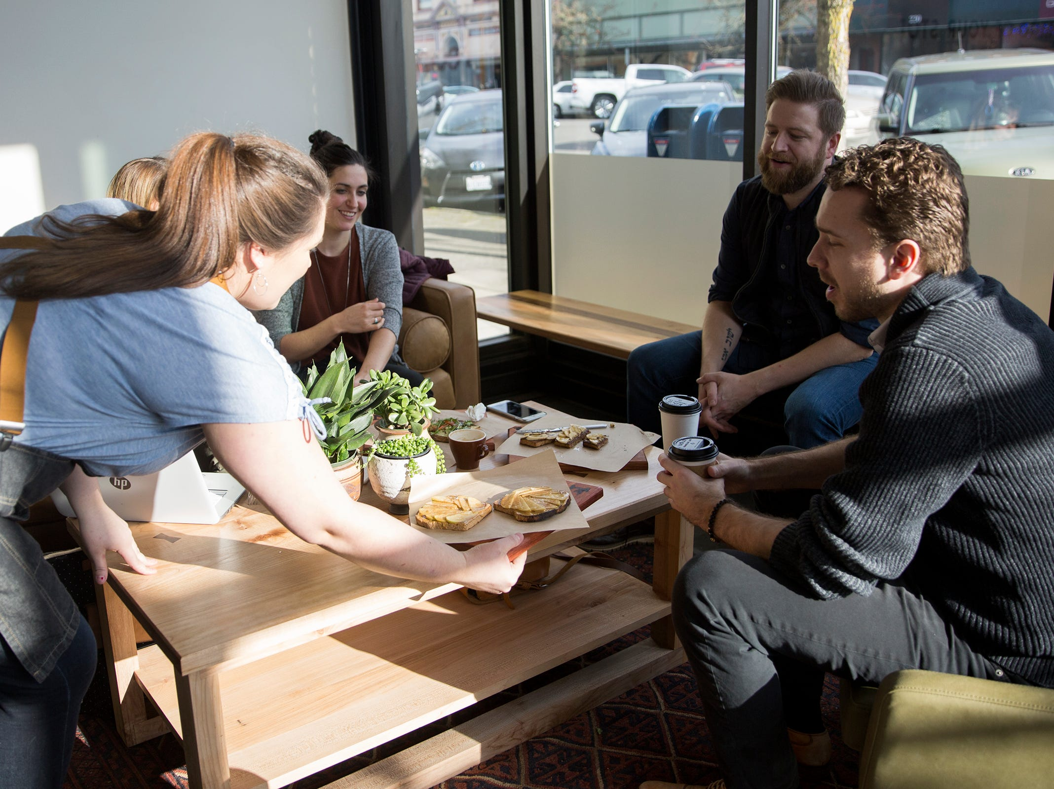 Customers and employees of Isaac's Downtown test-taste toast and menu items on Wednesday, Jan. 2, 2019.