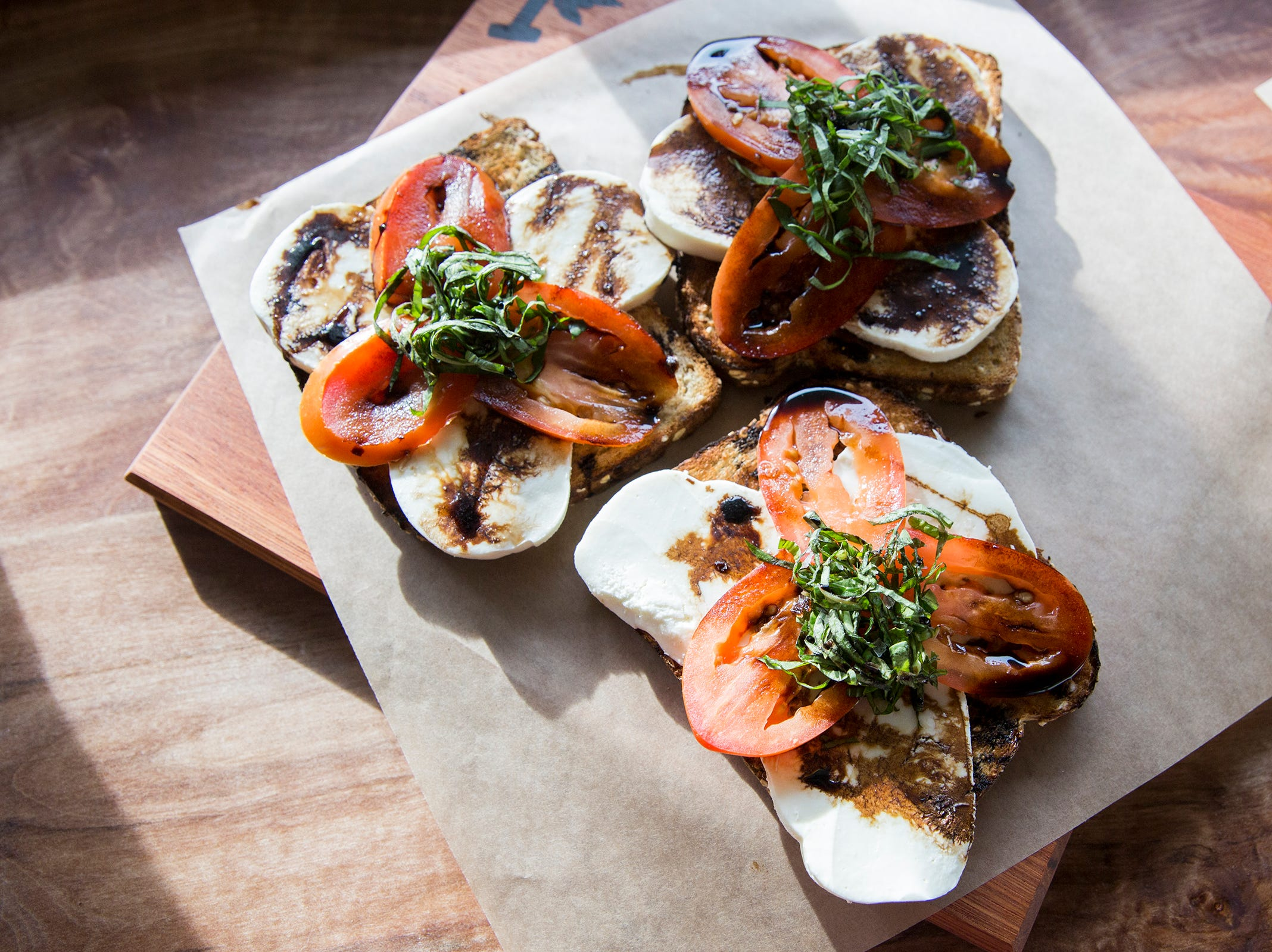 Toast with fresh mozzarella, tomato, basil, balsamic and sea salt is pictured at Isaac's Downtown in downtown Salem on Thursday, Jan. 3, 2019. The menu item is called Verona.