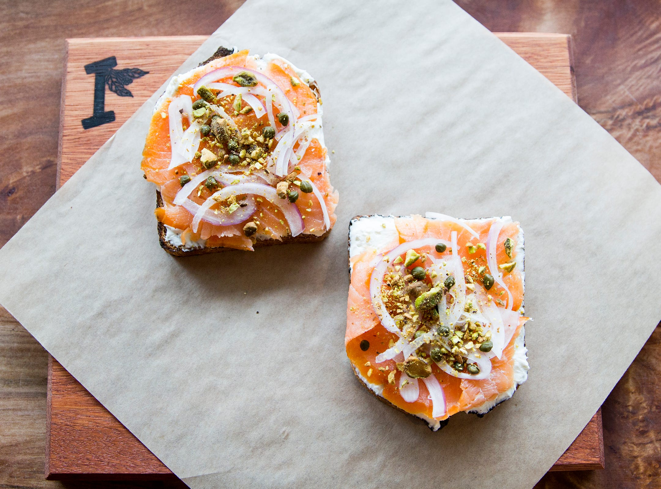 Toast with cream cheese, lox, capers, red onion and pistachios at Isaac's Downtown in Salem on Thursday, Jan. 3, 2019. The menu item is called Brooklyn.