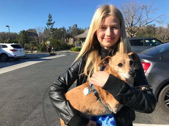 """Sofia Jordan, 11, poses with her 12-year-old dog """"Bailey"""" in Prunedale."""