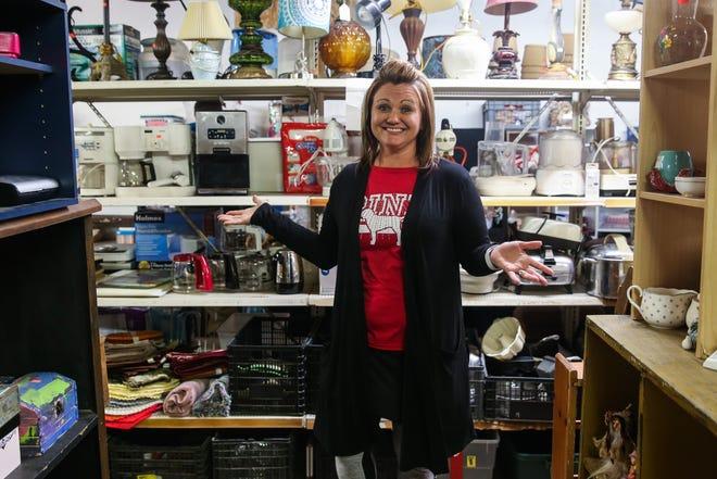 Brandy Hopper walks through the showroom Thursday, Jan. 3, 2019, at Bargain Cave.