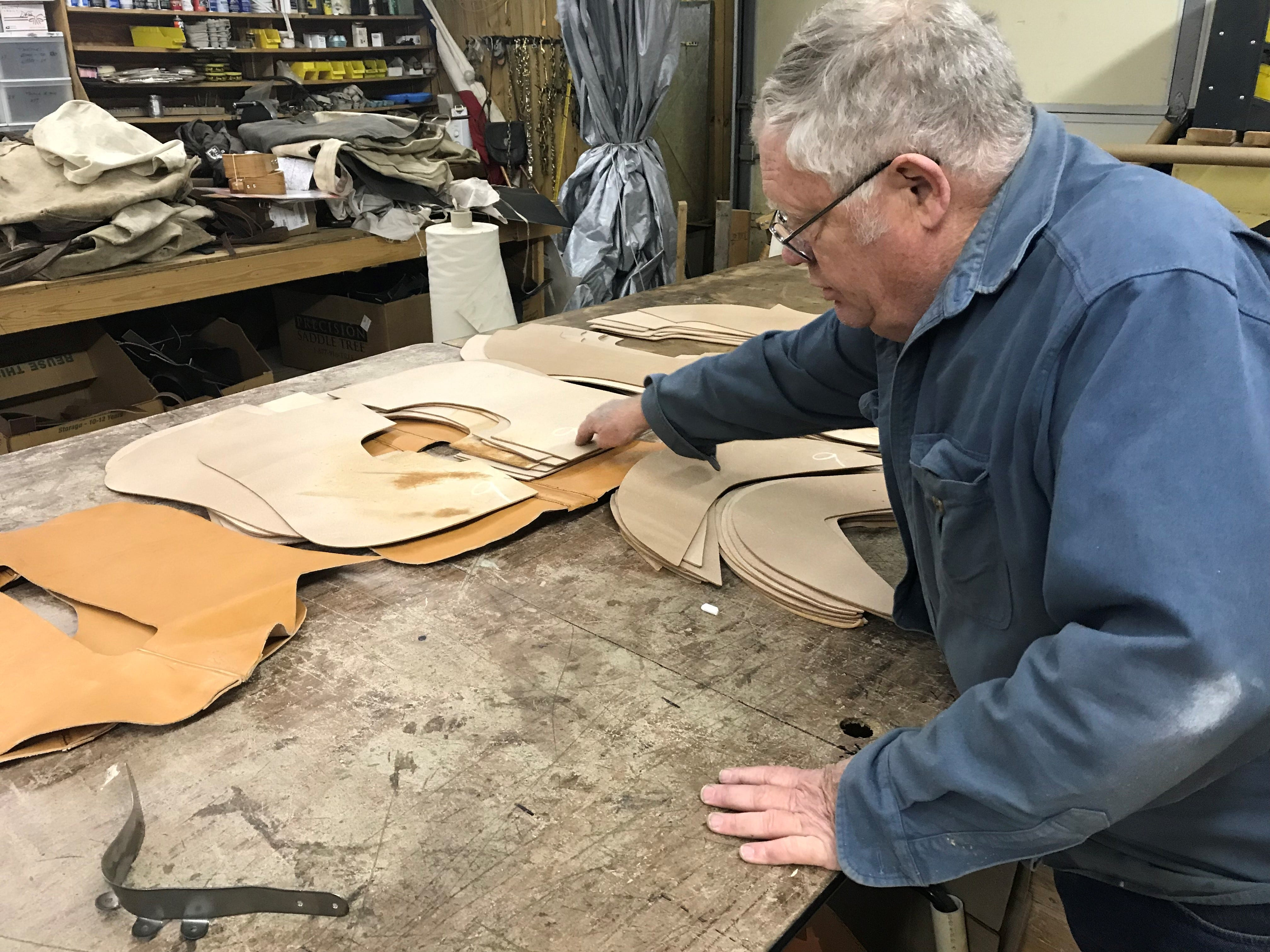 Nils Shawn Pascuzzi shows how to measure leather needed to be cut at Shawn's Custom Saddles and Tacks, 6581 Sykes Circle. Photo taken Jan. 2, 2019.