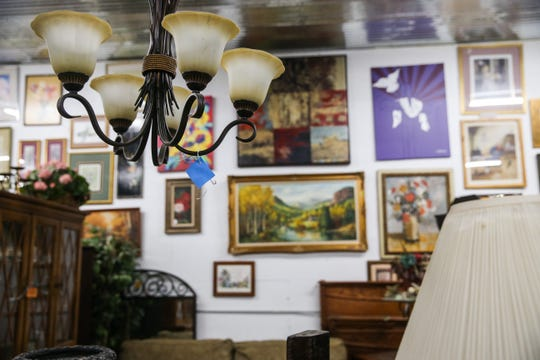 Lamps and paintings adorn the walls at Bargain Cave.