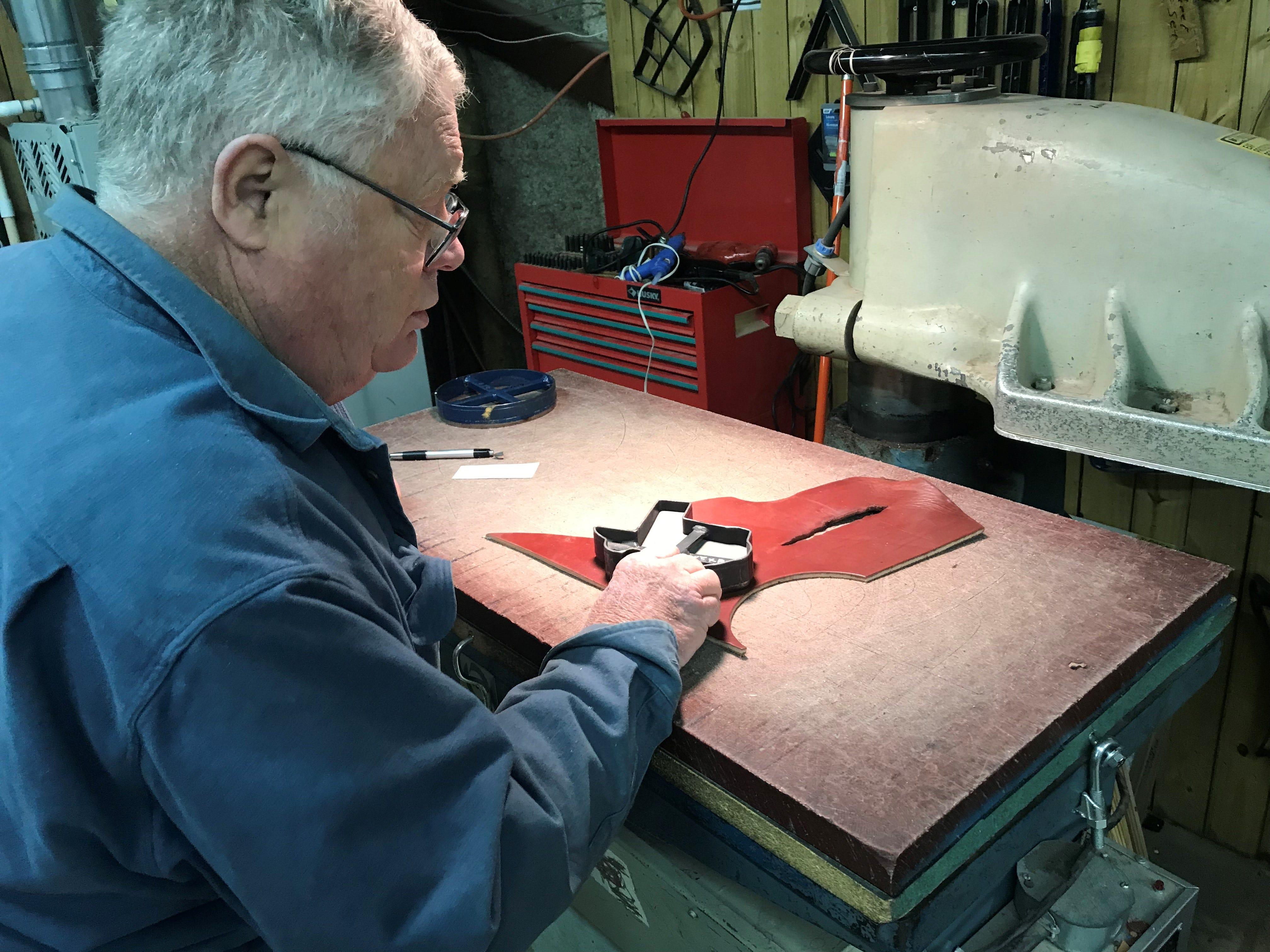 Nils Shawn Pascuzzi cuts leather at Shawn's Custom Saddles and Tacks, 6581 Sykes Circle. Photo taken Jan. 2, 2019.
