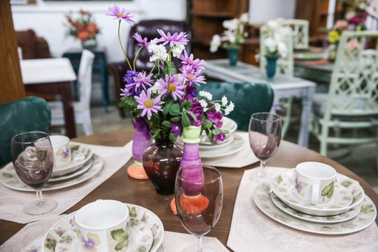 Dinner sets adorn tables for sale at Bargain Cave.