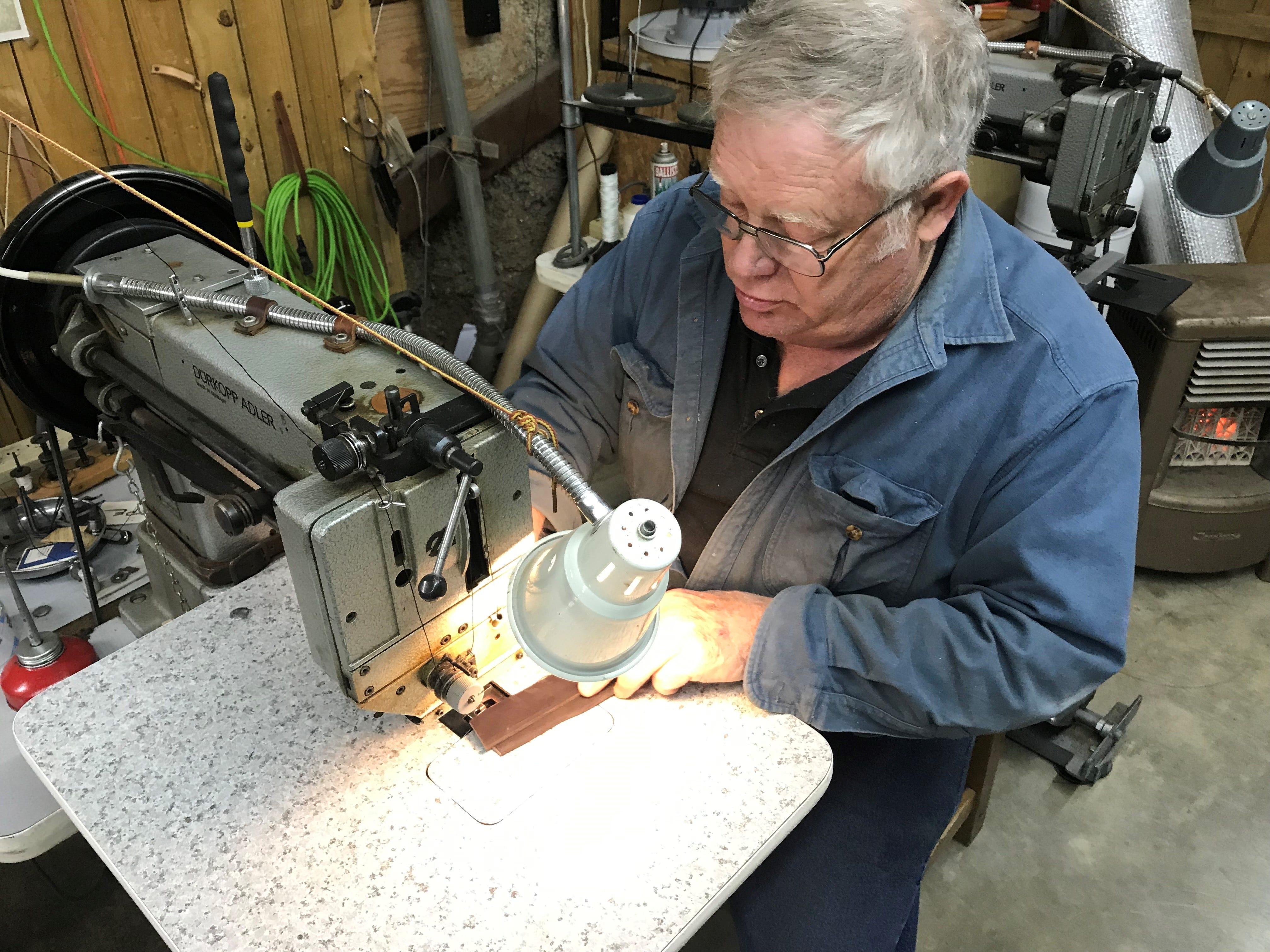Nils Shawn Pascuzzi sews leather at Shawn's Custom Saddles and Tacks, 6581 Sykes Circle. Photo taken Jan. 2, 2019.