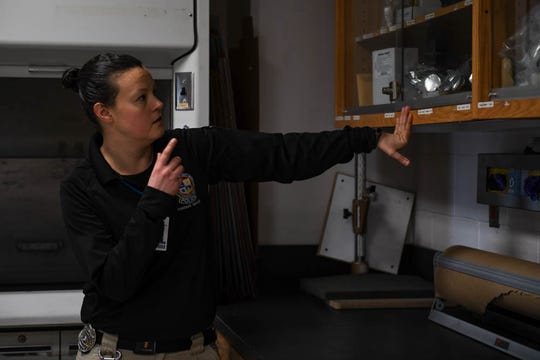 Crime Tech Nicole Ruggiero points to equipment in the forensic lab in the Ocean City Police Department on Friday, Dec 21, 2018.