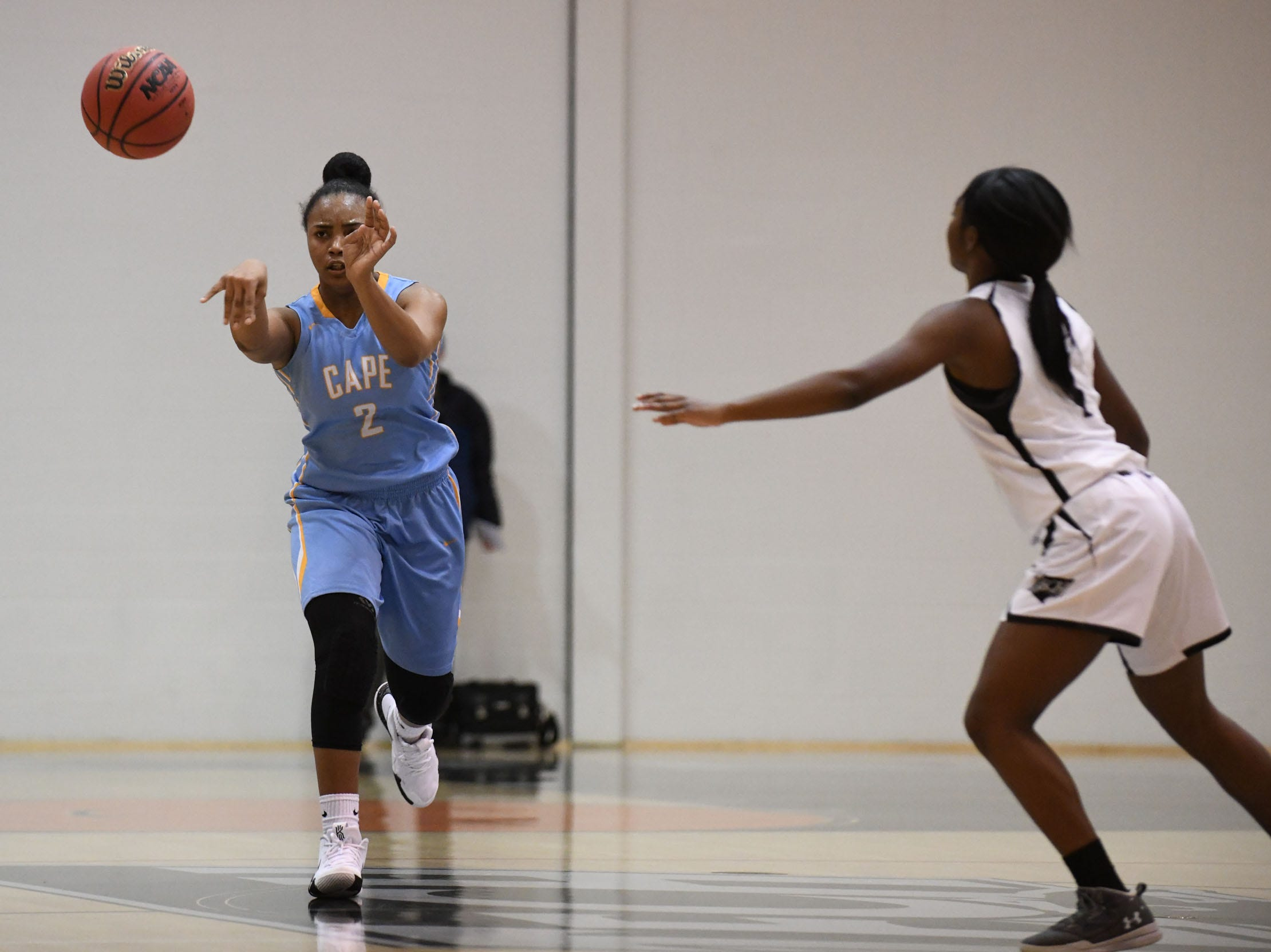 Cape Henlopen's Mehkia Applewhite passes to her teammate against Sussex Tech on Wednesday, Jan. 2, 2019.