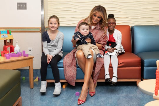 First Lady Melania Trump poses for a photo with patients at Children's National Thursday, Dec. 13, 2018, during a Christmas visit to the hospital in Washington, D.C. (Official White House Photo by Andrea Hanks) Courtesy of The White House.