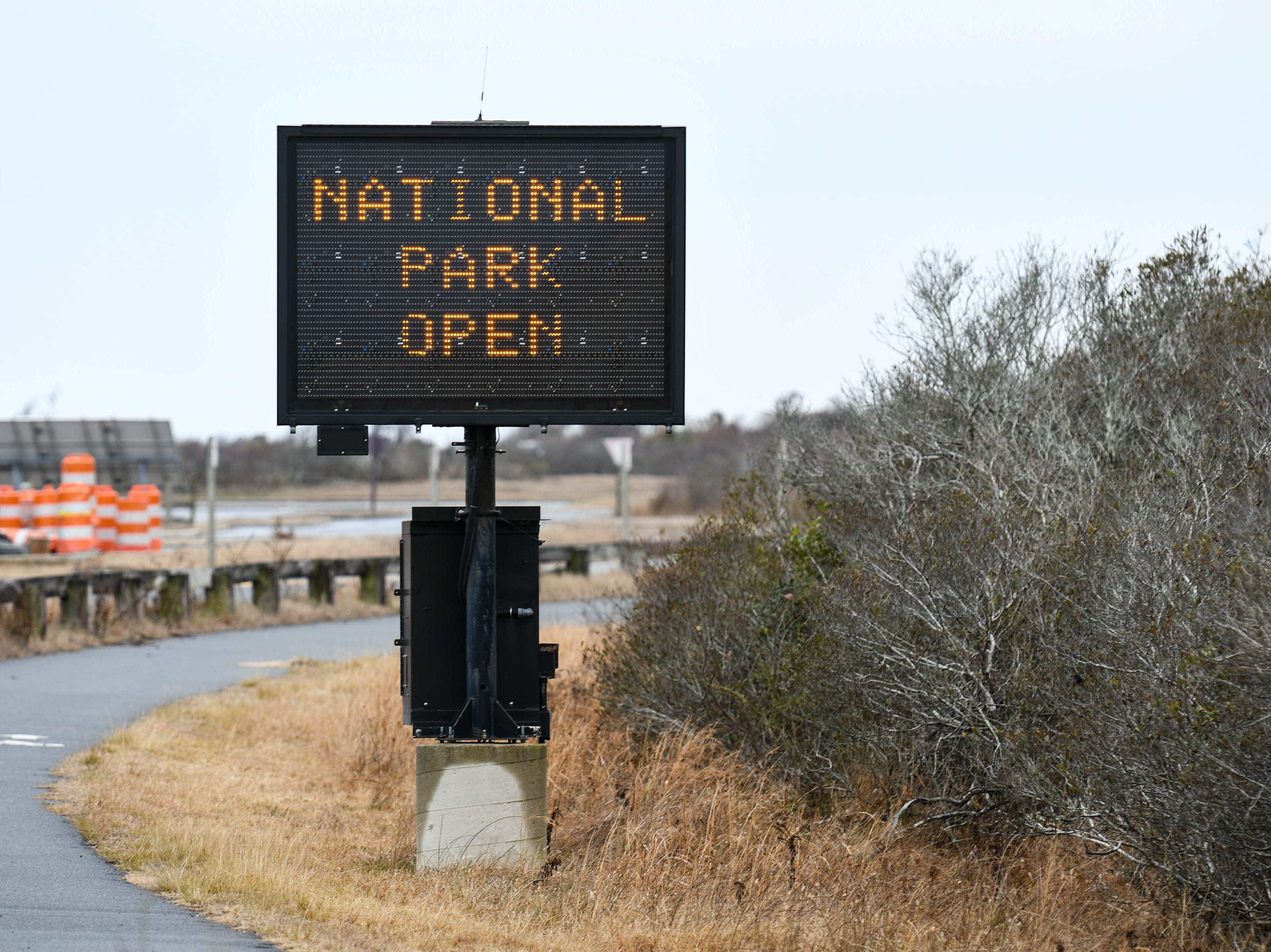 Signs notify visitors of a lack of facilities at Assateague National Park on Thursday, Jan 3, 2018. The park remains open during the federal government shutdown, however visitors services are not being provided.