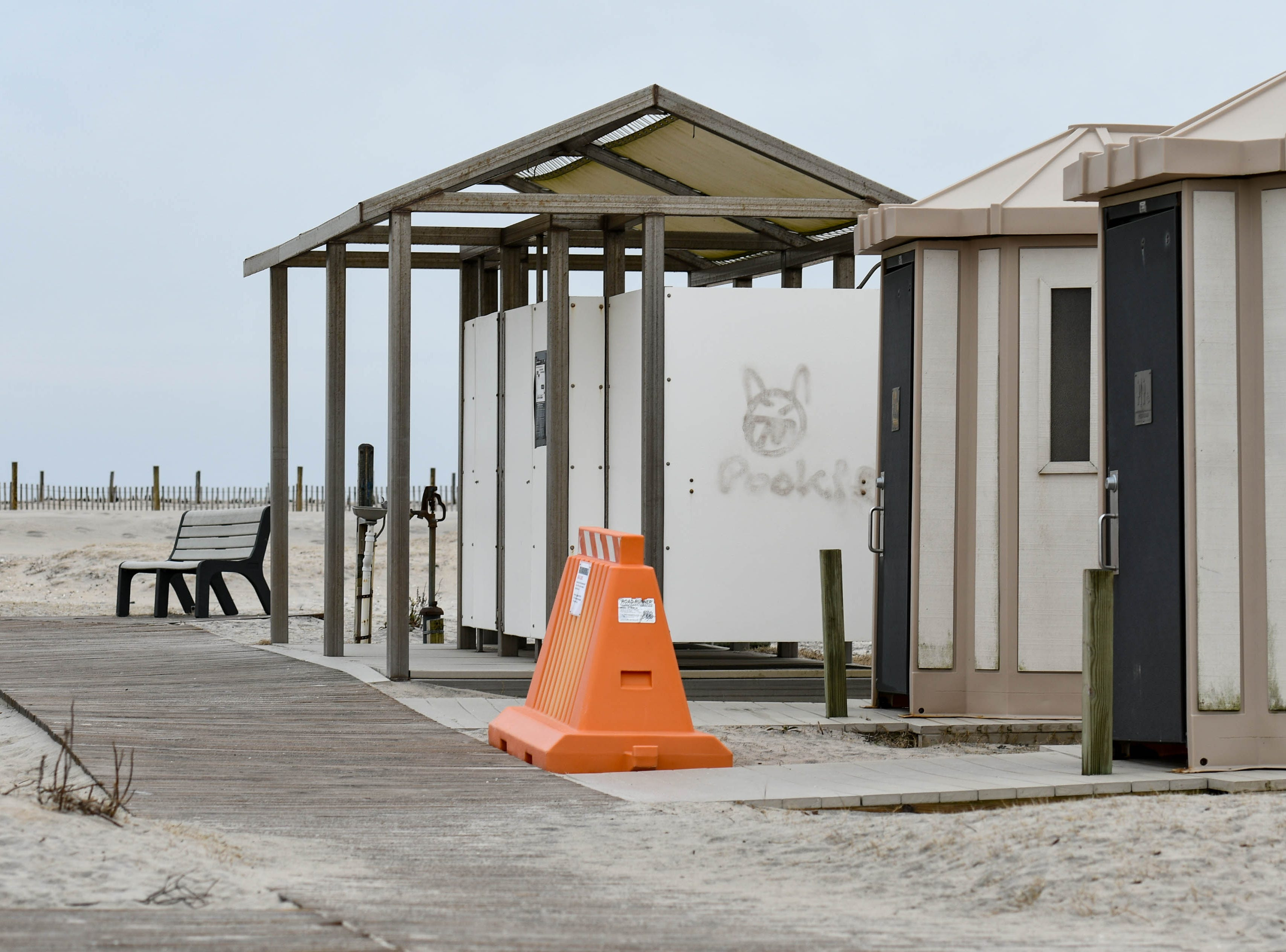 Orange barriers block off bathrooms at Assateague National Park on Thursday, Jan 3, 2018. The park remains open during the federal government shutdown, however visitors services are not being provided.