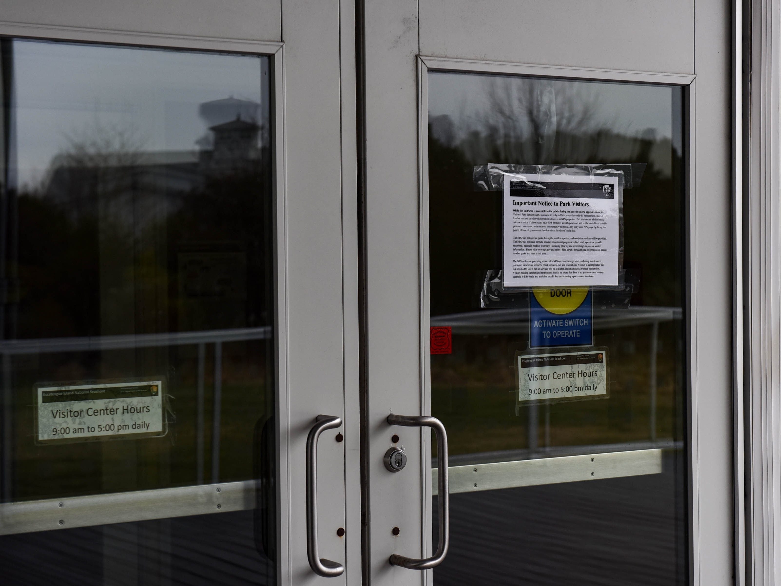 Signs notify visitors of a lack of facilities at the visitor's center in Assateague National Park on Thursday, Jan 3, 2018. The park remains open during the federal government shutdown, however visitors services are not being provided.