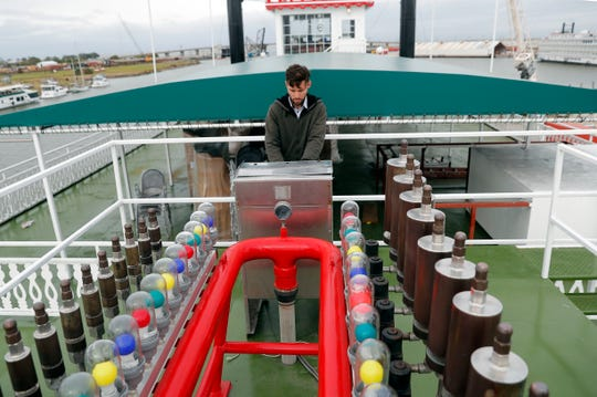 """In this Nov. 29, 2018, photo, Matt Dow, project manager for the restoration of the """"City of New Orleans"""" riverboat, plays the calliope on the vessel in New Orleans."""
